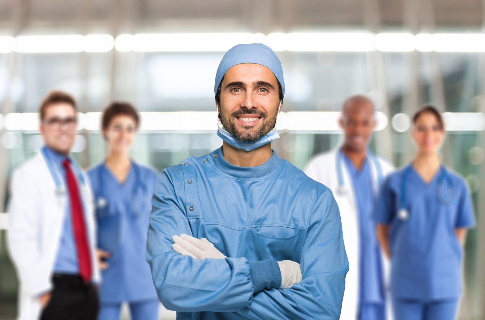 Smiling doctor in front of his team